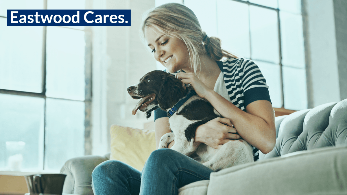 Woman with dog with text Eastwood Cares