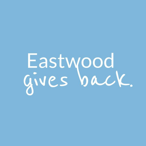 Eastwood Gives Back on a blue background